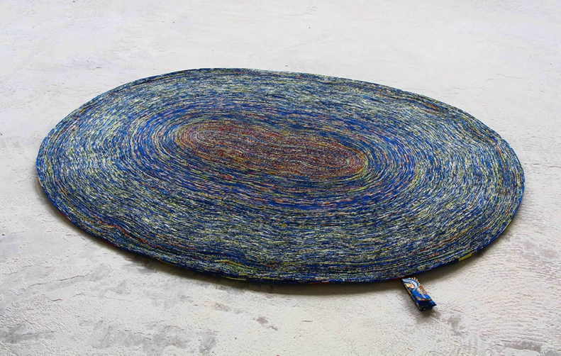 http://www.simonepost.nl/files/gimgs/th-52_carpet-oval-blue-yellow-light-simone-vlisco-post-waste-recycled.jpg